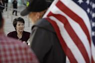 Carol Bundy, left, wife of Nevada rancher Cliven Bundy, speaks with supporters outside of the federal courthouse, Thursday, Feb. 9, 2017, in Las Vegas. A jury begins to decide Thursday in Las Vegas if six men who wielded weapons to block a federal round-up of cattleman Cliven Bundy's cows in 2014 were citizens exercising constitutional free speech and weapon rights or armed insurrectionists who conspired against the government. (AP Photo/John Locher)