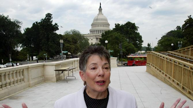 "FILE - This June 11, 2003 file photo shows Martha Burk, of the National Council of Women's Organizations, gesturing during a news conference on Capitol Hill in Washington. For the first time in its 80-year history, Augusta National Golf Club has female members. ""This is a joyous occasion,"" Augusta National chairman Billy Payne said Monday, Aug. 20, 2012. The move likely ends a debate that intensified in 2002 when Burk urged the club to include women among its members.  (AP Photo/Rick Bowmer, File)"
