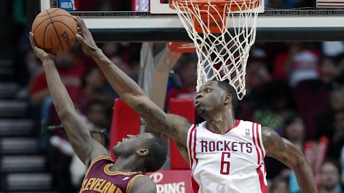 Houston Rockets' Terrence Jones (6) reaches out to block a shot by Cleveland Cavaliers' Dion Waiters (3) in the second half of an NBA basketball game Saturday, Feb. 1, 2014, in Houston. The Rockets won 106-92