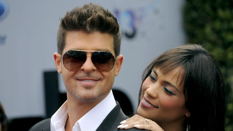 Robin Thicke and his wife Paula Patton arrive at the BET Awards at the Nokia Theatre on Sunday, June 30, 2013, in Los Angeles. (Photo by Chris Pizzello/Invision/AP)