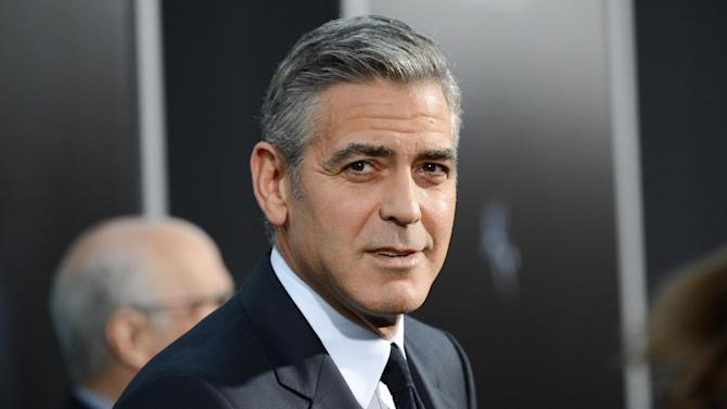 "FILE - In this Oct. 1, 2013 file photo, actor George Clooney attends the premiere of ""Gravity"" at the AMC Lincoln Square Theaters, in New York. The Britannia Awards, handed out by the Los Angeles branch of the British Academy of Film and Television Arts, promise an all-star cast. Presenters including Julia Roberts, Sean Penn, Sigourney Weaver and Chiwetel Ejiofor will honor recipients such as Clooney, Ben Kingsley, Kathryn Bigelow, and Sacha Baron Cohen, on Saturday, November 9, 2013, at the Beverly Hilton Hotel, in Los Angeles. (Photo by Evan Agostini/Invision/AP, File)"