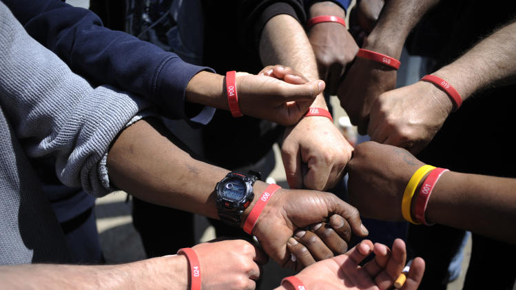 Job seekers show their wristbands as they wait in front of the training offices of Local Union 46 in the Queens borough of New York