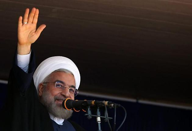 A handout picture released by the official website of the Iranian president shows President Hassan Rouhani speaking in Khoramabad on June 18,2014