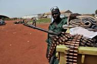 "A Sudanese soldier poses next to a machine gun in the oil region of Heglig. Khartoum's warplanes bombed border regions, leading South Sudan's leader on Tuesday to accuse Sudan of declaring war, as the United States condemned the ""provocative"" strikes"