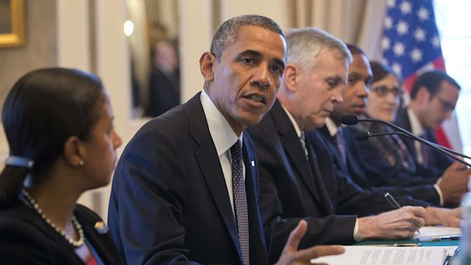 U.S. President Barack Obama, center, with members of his delegation, speaks during his bilateral meeting with China's President Xi Jinping, unseen, at the G20 Summit, Friday, Sept. 6, 2013 in St. Petersburg, Russia. (AP Photo/Pablo Martinez Monsivais)