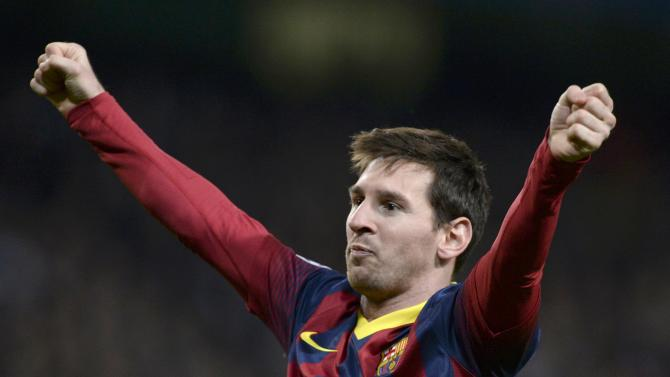 Barcelona's Lionel Messi celebrates after scoring a penalty against Manchester City during their Champions League round of 16 first leg soccer match at the Etihad Stadium in Manchester