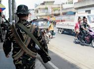 Philippine soldiers patrol the streets as government forces clash with Muslim rebels in Zamboanga City, on September 21, 2013