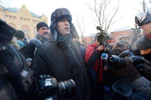 Russian opposition activist Alexei Navalny attends an opposition protest marking one year since the start of protests against Vladimir Putin, in Moscow, on December 15, 2012. Russian investigators on Monday opened a third criminal case against Navalny.