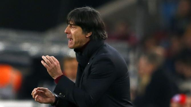 German national team coach Loew gestures during their international friendly soccer match against Chile in Stuttgart