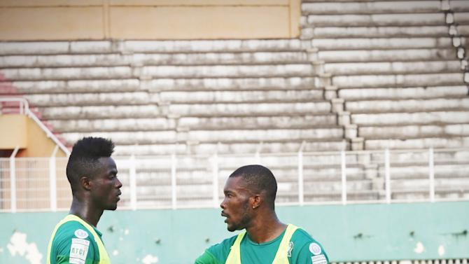 Ivory Coast's national soccer players Eric Bailly and Serey Die attend a training session at the Felix Houphouet-Boigny stadium in Abidjan