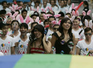 A group of participants march in front of their gay pride flag during the annual Pride March in Manila, Philippines, Saturday, Dec. 3, 2011. Lesbians, gays, bisexual and transgenders called for the urgent need to pass the anti-discrimination bill and for government protection from hate crimes committed against them. (AP Photo/Pat Roque)