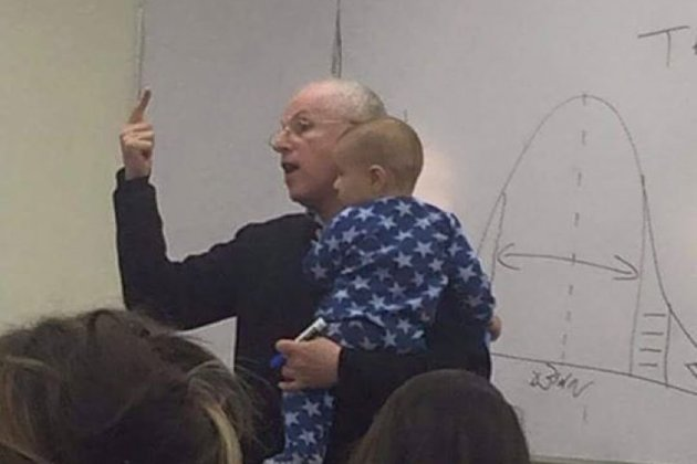 Here's why this photo of a professor holding his student's baby is going viral.