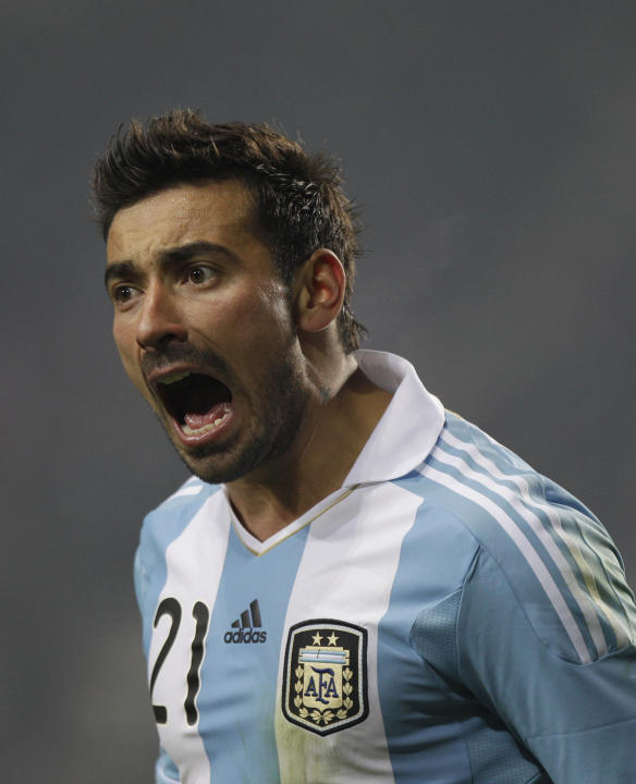 Argentina's Ezequiel Lavezzi reacts during a Copa America soccer match against Bolivia in La PLata, Argentina, Friday July 1, 2011. (AP Photo/Eduardo Di Baia)