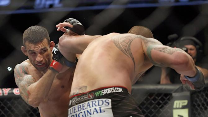 Fabricio Werdum, left, and Travis Browne fight during a UFC mixed martial arts bout on Saturday, April 19, 2014, in Orlando, Fla. Werdum won