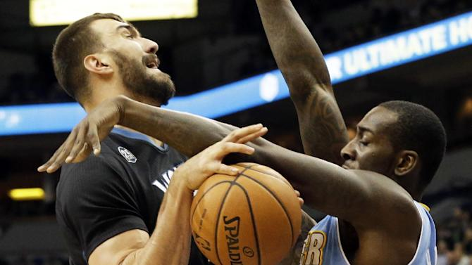 Minnesota Timberwolves' Nikola Pekovic, left, of Montenegro, gets tied up during a shot-attempt by Denver Nuggets' J.J. Hickson in the first quarter of an NBA basketball game on Wednesday, Nov. 27, 2013, in Minneapolis