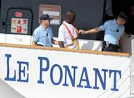 "French police escort a suspected Somali pirate during a reconstruction of events surrounding the hijacking of the luxury sailing ship ""Le Ponant"" in 2008. Le Ponant left the Seychelles on March 30, 2008 with 30 crew and no passengers on board, headed for Yemen where they were to take on passengers for a cruise. On route the ship was boarded by pirates"