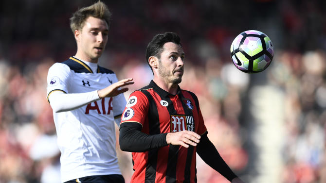 Tottenham's Christian Eriksen in action with Bournemouth's Adam Smith