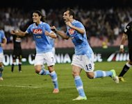 SC Napoli's forward Goran Pandev (R) celebrates with teammate Edinson Cavani after scoring during the Serie A football match between SSC Napoli and Udinese at the San Paolo Stadium in Naples. Napoli won 2-1