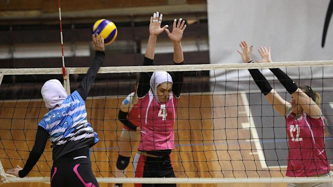 Iranian volleyball players Borhani and Giveh take part in a training session in Shumen