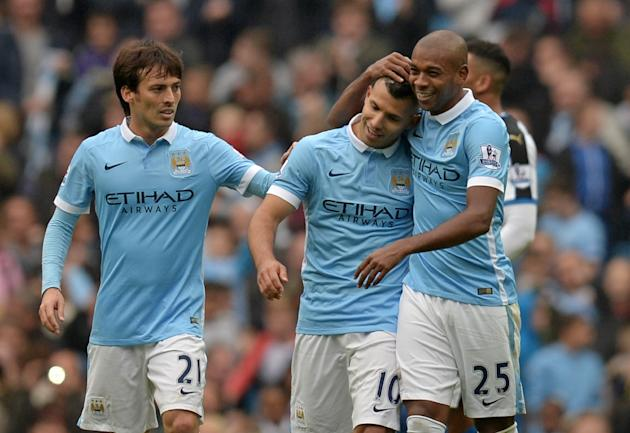 Manchester City's Sergio Aguero (C) celebrates with teammates Fernandinho (R) and David Silva after scoring a goal during their English Premier League match against Newcastle United, at the Etihad