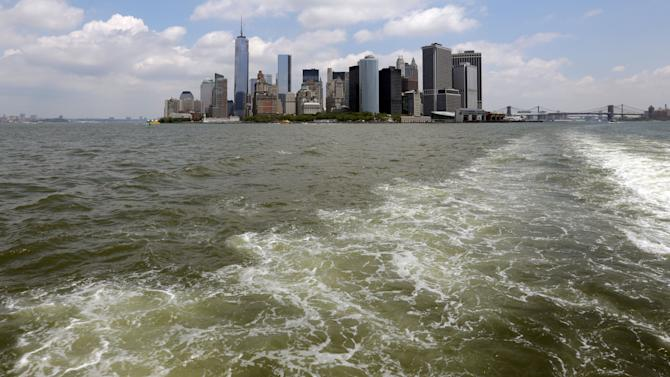 In this Tuesday, June 11, 2013, photo, lower Manhattan is visible from the Staten Island Ferry, in New York's Upper Bay. Giant removable floodwalls would be erected around lower Manhattan, and levees, gates and other defenses could be built elsewhere around the city under a nearly $20 billion plan proposed Tuesday by Mayor Michael Bloomberg to protect New York from storms and the effects of global warming. (AP Photo/Richard Drew)