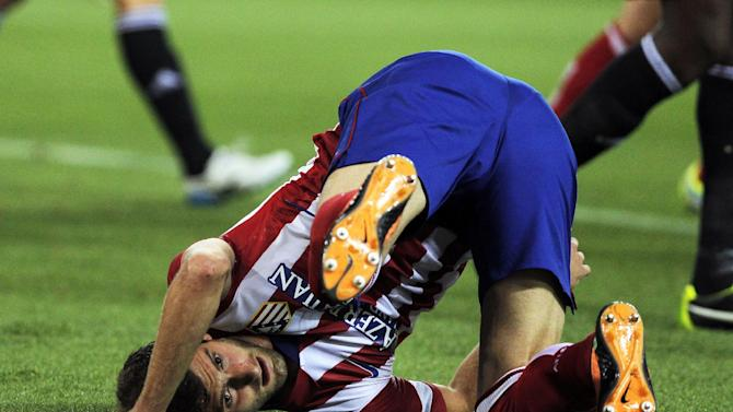 Atletico de Madrid's Leo Baptistao from Brazil falls during a Spanish La Liga soccer match against Osasuna at the Vicente Calderon stadium in Madrid, Spain, Tuesday, Sept. 24, 2013