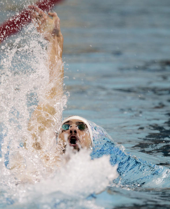 Michael Phelps, of the United States, competes in the men's 100-meter backstroke final during the Minnesota Grand Prix swimming event in Minneapolis, Saturday, Nov. 12, 2011. Phelps won the event. (AP