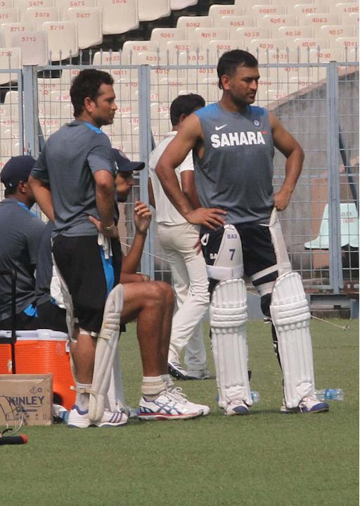 Indian cricketers Sachin Tendulkar and M S Dhoni during a practice session ahead of the test match series between India and West Indies starting on Nov 6 at Eden Gardens in Kolkata on Nov.4, 2013. (Ph