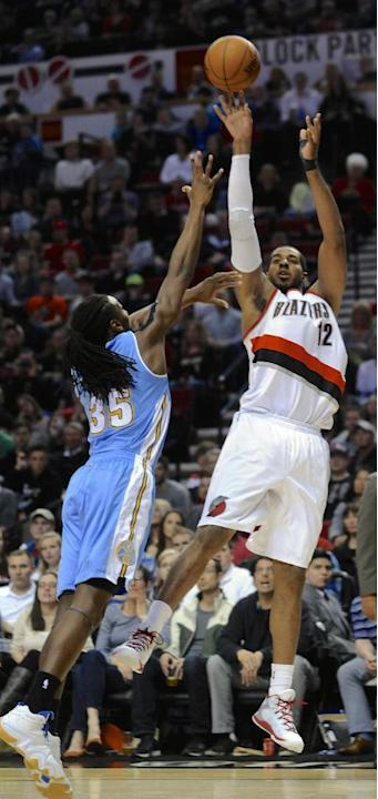 Portland Trail Blazers' LaMarcus Aldridge, right, shoots against Denver Nuggets' Kenneth Faried (35) during the second half of an NBA basketball game in Portland, Ore., Saturday, March 28, 201