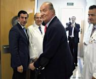 Spanish King Juan Carlos (C) leaves San Jose hospital on April 18, in Madrid. The king underwent surgery for a second time Thursday, the royal palace said, after suffering a broken hip during a much-criticised Botswana hunting trip and receiving a prosthesis