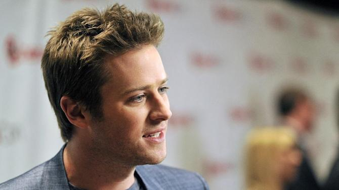 """Armie Hammer, who stars in the title role in the upcoming film """"The Lone Ranger,"""" is interviewed backstage at the Walt Disney Studios presentation at CinemaCon 2013 at Caesars Palace on Wednesday, April 17, 2013 in Las Vegas. (Photo by Chris Pizzello/Invision/AP)"""