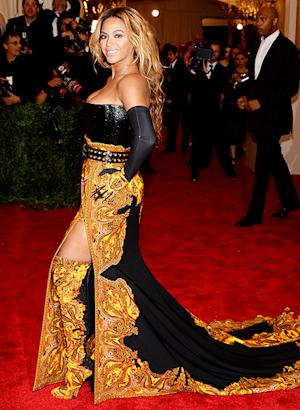 Beyonce Hits Met Gala in Corset, Long-Train Dress, Thigh-High Boots
