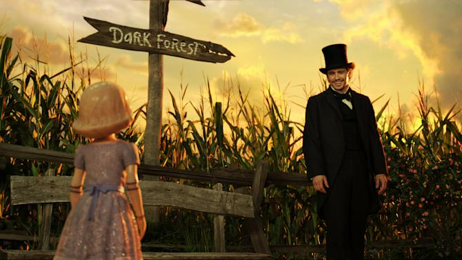 "This film image released by Disney Enterprises shows the character China Girl, voiced by Joey King, left, and James Franco, as Oz, in a scene from ""Oz the Great and Powerful."" (AP Photo/Disney Enterprises)"