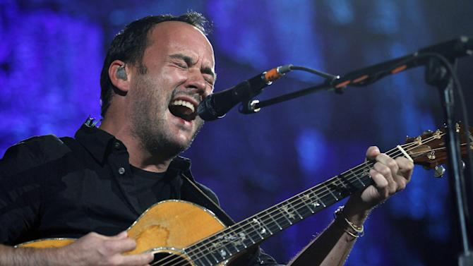 FILE - In this Oct. 2, 2010, file photo, Dave Matthews performs during the 25th anniversary Farm Aid concert in Milwaukee. The annual Farm Aid benefit concert is coming to Hershey, Pa., in September 2012 as the country's small and medium-size farms face a shifting economic landscape, but board member Dave Matthews sees some hopeful signs in the uncertainty. Matthews, who will perform at the Hersheypark show on Sept. 22 with longtime collaborator Tim Reynolds, sees demand growing for the types of farm products produced by smaller operations. (AP Photo/Jeffrey Phelps, File)