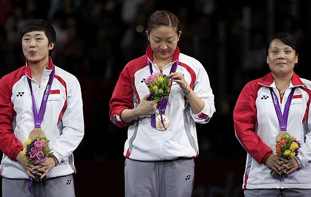 Feng Tianwei and co. bring home a second bronze, Singapore's best-ever medal tally at the Olympics. (Reuters)