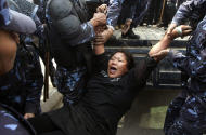 Nepal police detain a Tibetan who was shouting anti-China slogans in tribute to the Tibetans who died in the recent self-immolation, in Katmandu, Nepal, Tuesday, Nov. 1, 2011. Nepal police detained more than 100 Tibetans exiles who were protesting against the Chinese rule over their homeland. (AP Photo/Binod Joshi)