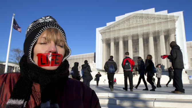 Anti-abortion activist, Jenese English, voices her opinion in front of the U.S. Supreme Court in Washington, Tuesday, Jan. 22, 2013 coinciding with the 40th anniversary of Roe v. Wade, the Supreme Court decision that legalized abortion.   (AP Photo/Manuel Balce Ceneta)