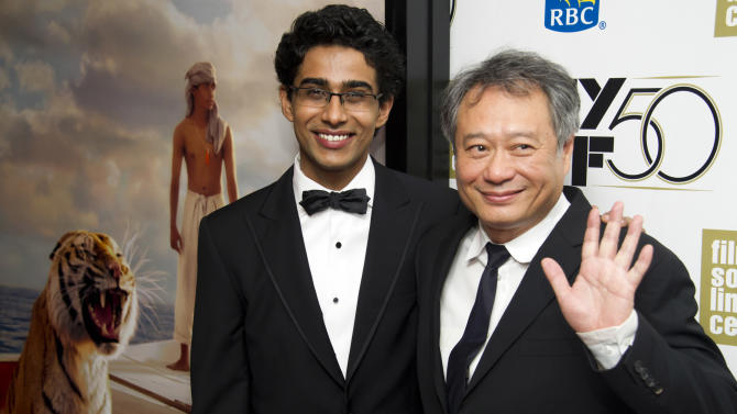 "FILE - This Sept. 28, 2012 file photo shows director Ang Lee, right, and actor Suraj Sharma at the premiere of ""Life of Pi"" at the 50th annual New York Film Festival in New York. Sharma credits director Ang Lee with setting him on a path to continue with a career in movies.  Sharma told The Times of India in an interview published Tuesday, April 23, 2013, that getting to work with the Oscar-winning director on ""Life of Pi"" was a blessing. ""The amount I learned and did was awesome. Ang gave me a path. Before that, I didn't even know what I would do in life,"" he was quoted as saying. After making the movie, ""I know I want to tell stories,"" he said.  (Photo by Charles Sykes/Invision/AP, file)"