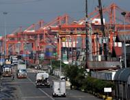 Cranes and container trucks are seen at the port of Manila on August 30. The Philippines said Thursday the economy grew a better-than-forecast 5.9 percent in the three months to June, largely due to a strong services sector