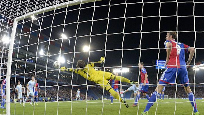 Basel's goalkeeper Yann Sommer saves a shot during a Champions League group E group stage soccer match between Switzerland's FC Basel 1893 and Romania's FC Steaua Bucharest at the St. Jakob-Park stadium in Basel, Switzerland, Wednesday, Nov. 6, 2013