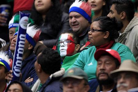 Fans of Mexico watch their World Cup qualifying playoff first leg soccer match against New Zealand, in Mexico City