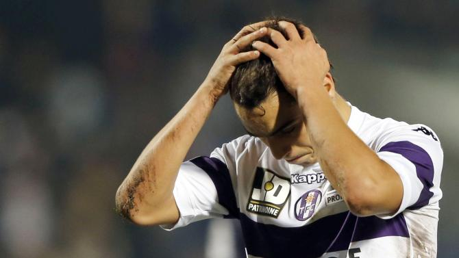 Toulouse's Wissam Ben Yedder reacts after missed a penalty during their French Ligue 1 soccer match against Girondins Bordeaux at the Chaban Delmas Stadium in Bordeaux
