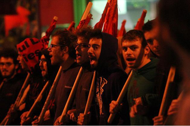 Demonstrators shout slogans during a protest against new government austerity bill, in Thessaloniki on November 7, 2012, as part of a 48-hour general strike. Greek lawmakers were locked in a fierce de