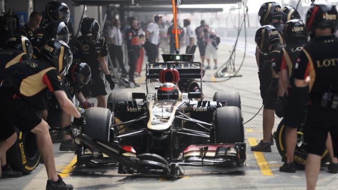 Lotus F1 Formula One driver Raikkonen is seen in his car during the third practice session of the Indian F1 Grand Prix at the Buddh International Circuit in Greater Noida