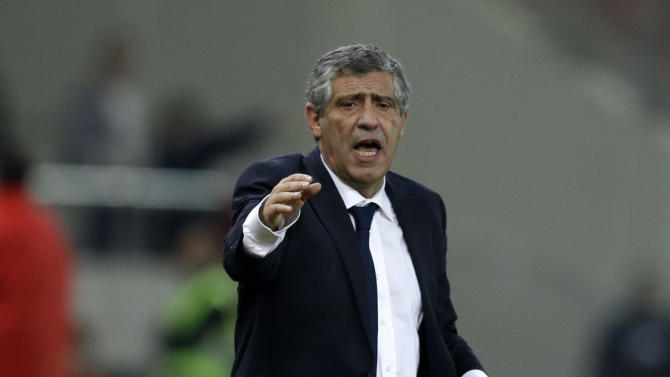 Greece's coach Fernando Santos instructs his players during a World Cup qualifying playoff first leg soccer match against Romania at the Karaiskaki stadium in the port of Piraeus, near Athens, Friday, Nov. 15, 2013. Greece won 3-1