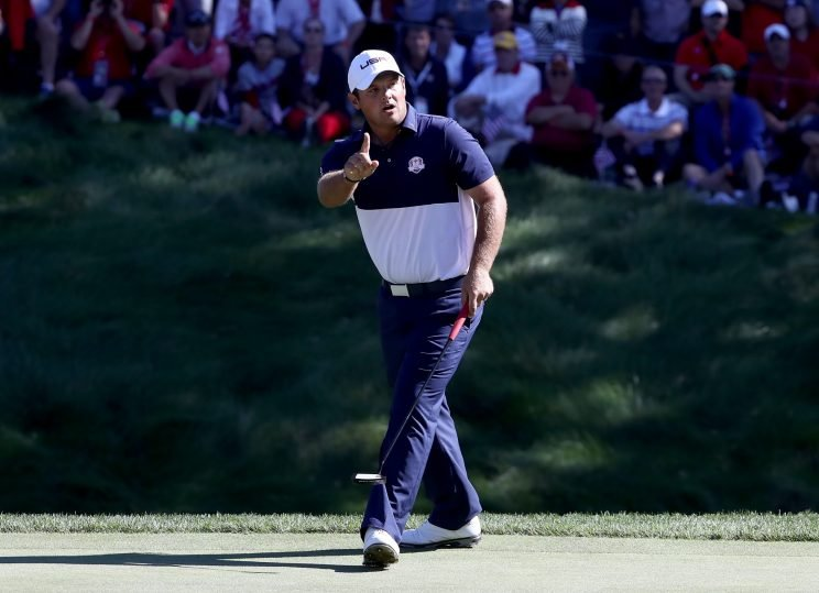 Patrick Reed wags his finger at Rory McIlroy after draining a birdie on the eighth. (Getty Images)
