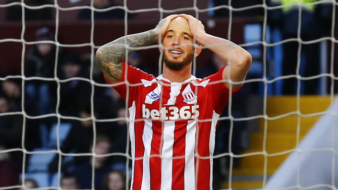 Football: stoke's stephen ireland looks dejected
