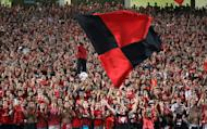 Egyptian fans of Al Ahly club cheer before a match in Cairo on August 29, 2010. Al Ahly of Egypt won a record-extending fifth CAf Super Cup title Saturday by beating AC Leopards of Congo Brazzaville 2-1 near Mediterranean city Alexandria