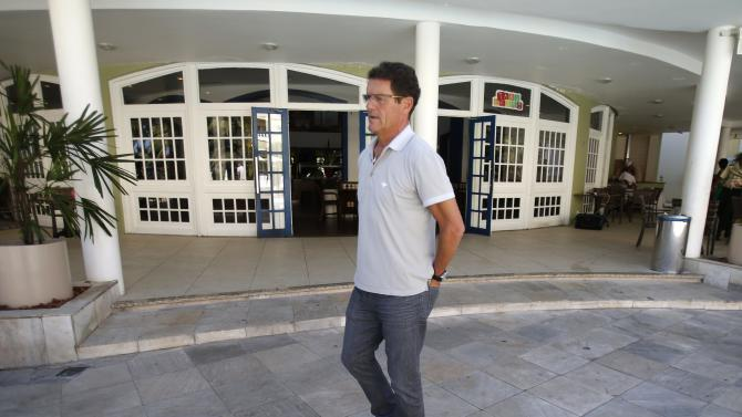Capello walks at the Costa do Sauipe resort ahead of the 2014 World Cup draw in Sao Joao da Mata