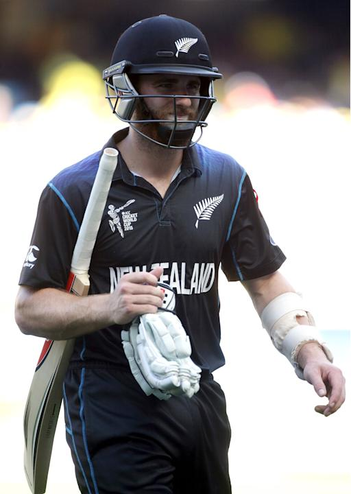 New Zealand's Kane Williamson reacts as he walks off the field after being dismissed by Australia's Mitchell Johnson for twelve runs during their Cricket World Cup final match at the MCG